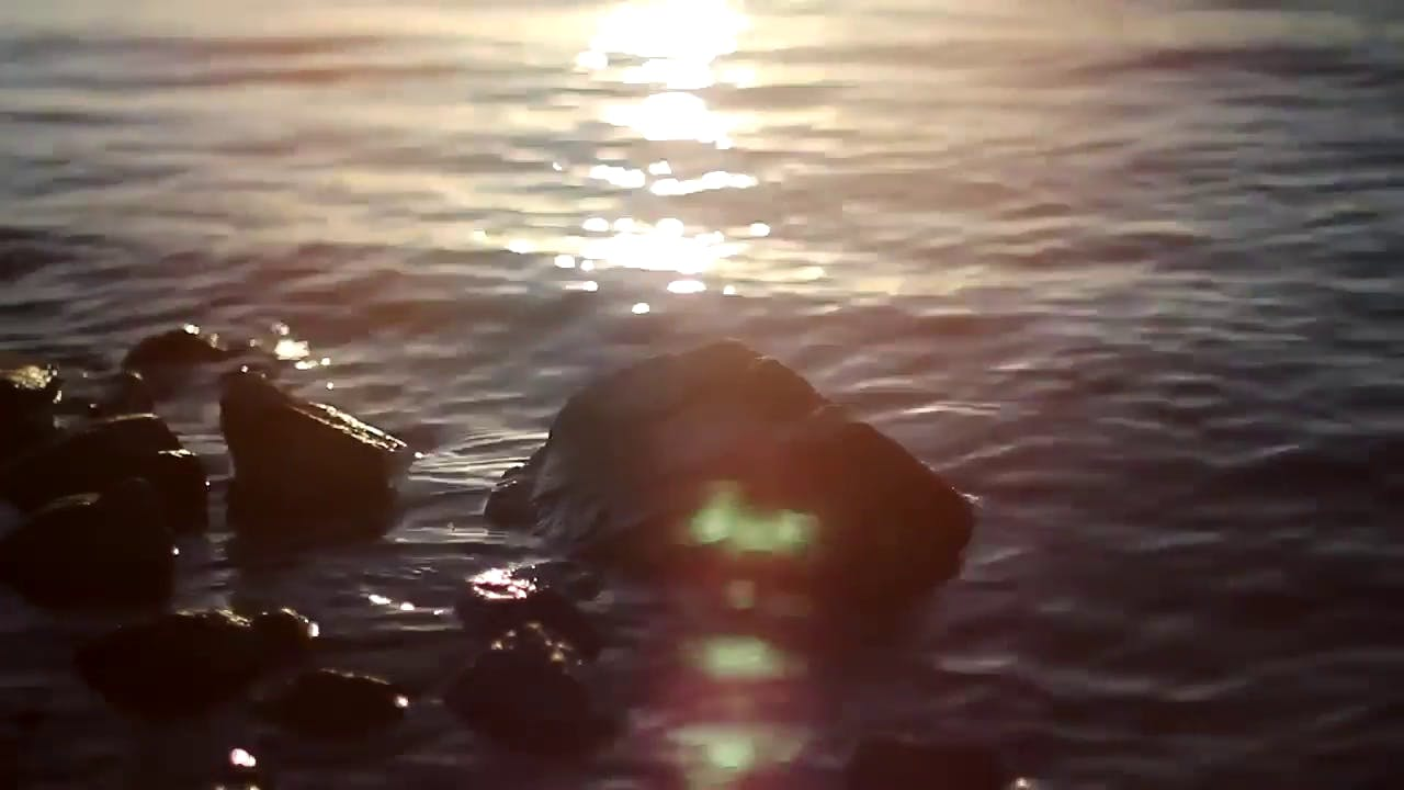 Sun glitters over the river stock video