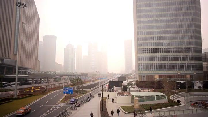 City view showing city fog in between huge buildings Free Stock Footage
