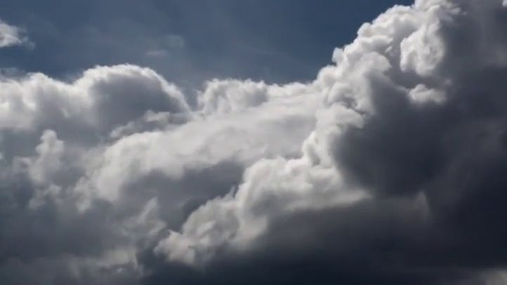 uplifting clouds filling the frame from bottom to top Stock Footage