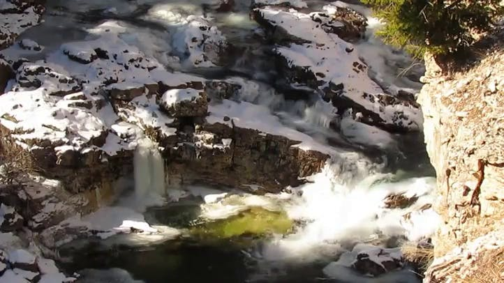 Frozen river on Boulder rocks in Sountwest Montana Free Stock Video Footage HD