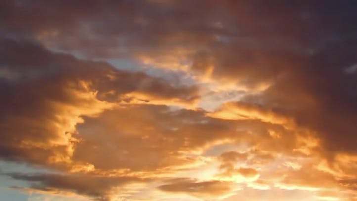 Beautiful Montanna sunrise with Clouds colored in yellow and orange Free Stock Footage