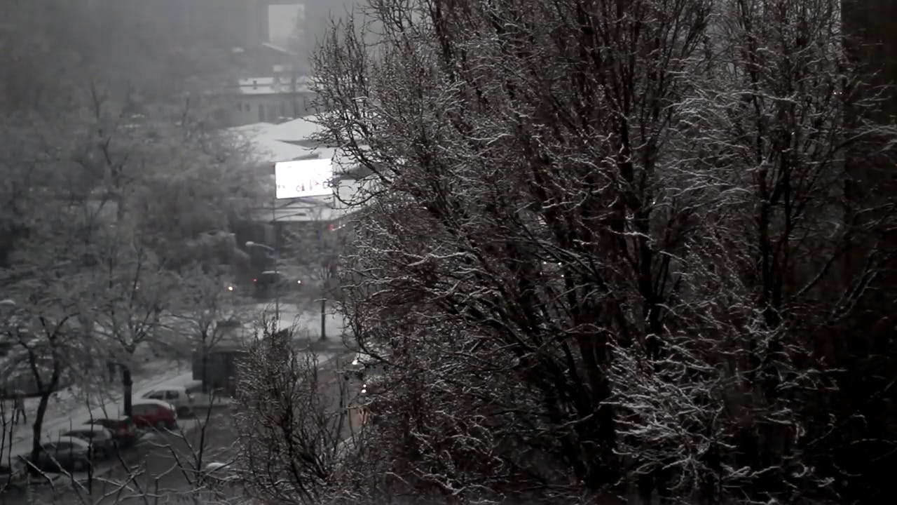 Bad Weather in the city snow falling Free stock footage