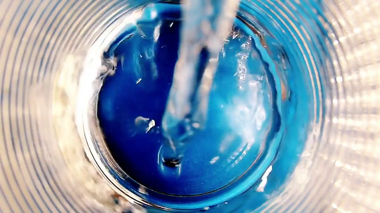Pouring of a glass of water in slow motion stock video