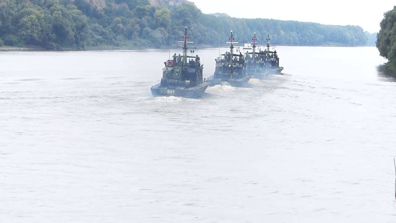 Military ships in river stock video