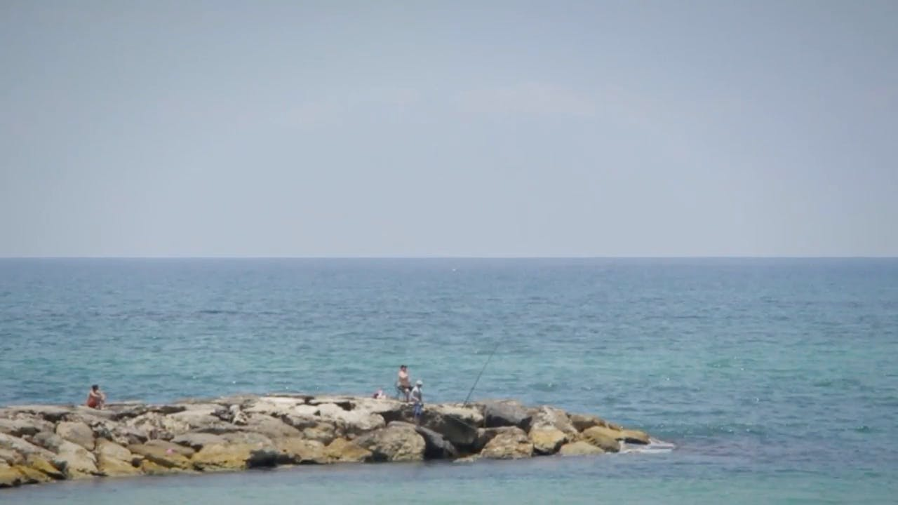 People Fishing In Sea Stock Footage