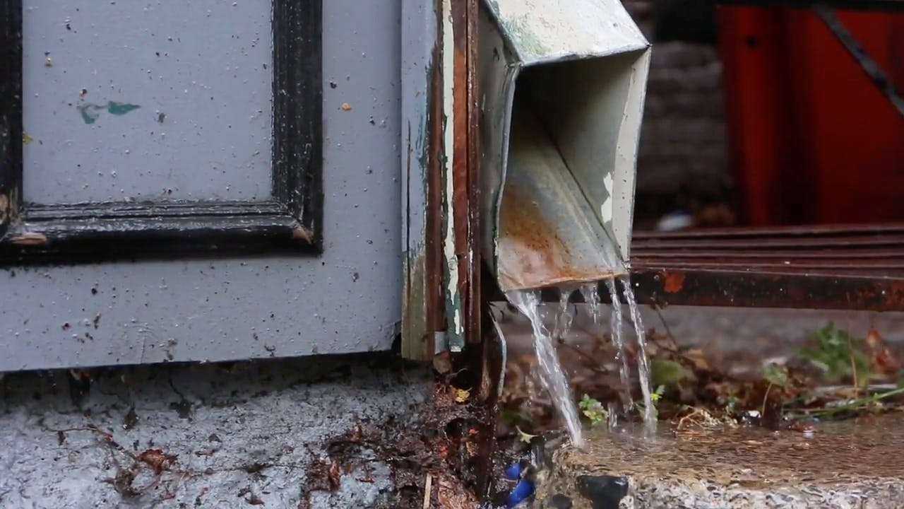 Water Flowing from Gutter Stock Video