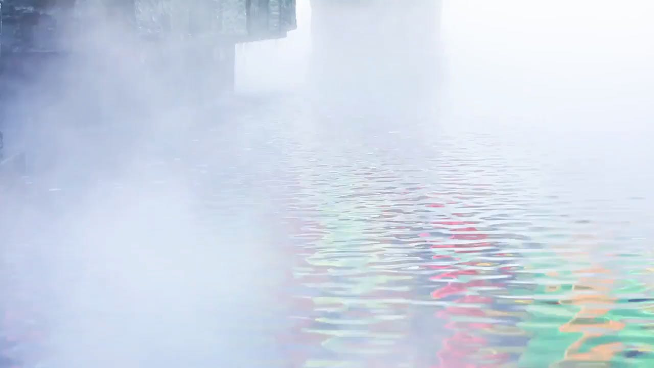 Colorful Water Reflections in Haze Stock Footage Clip