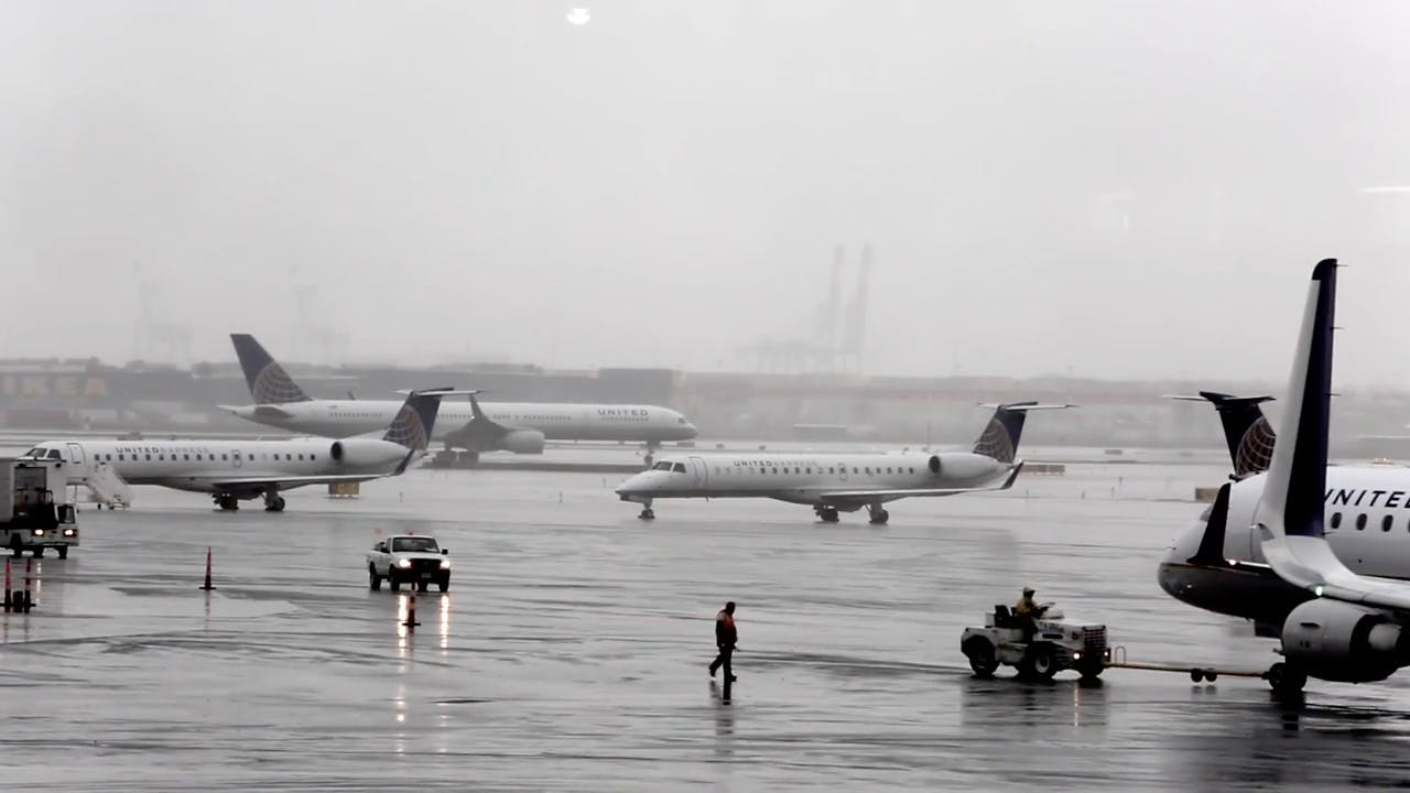 Planes in on Airport during rain Stock Footage Clip